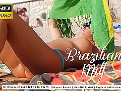 Milf, Beach, Big Ass, Brunette, Outdoor, Tattoo, Voyeur